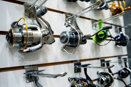 A variety of fishing reels. Fishing gear and accessories.