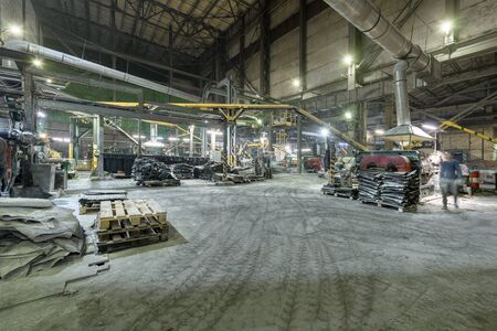 Interior of a factory for manufacturing rubber conveyor belts.