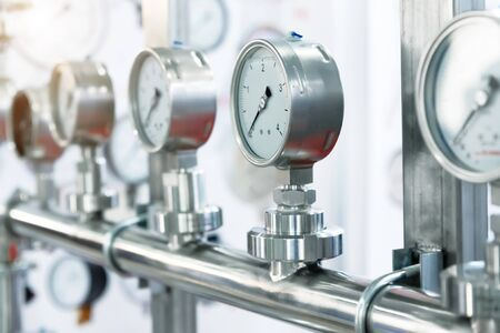 Many pressure gauges mounted on the pipeline.