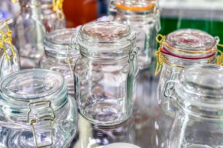 Glass jars with glass lockable lids.