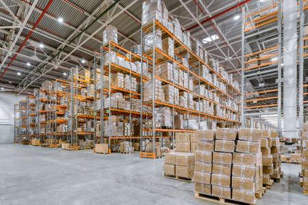 Large warehouse. Tall metal shelves