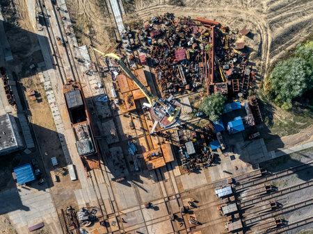 Large pile of scrap metal, gantry crane