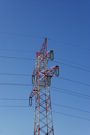 electricity pylon before blue sky photo