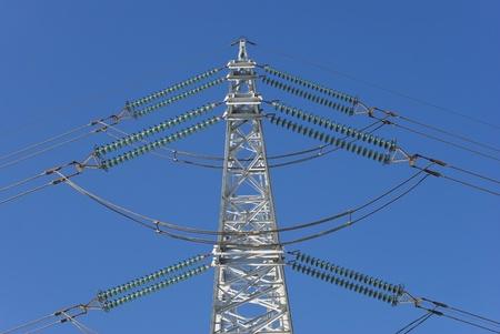 electricity pylon before blue sky photo