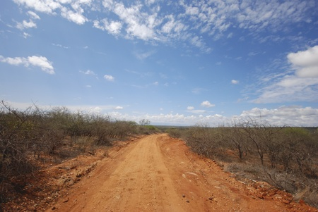 afrika: red road in east Afrika Stock Photo