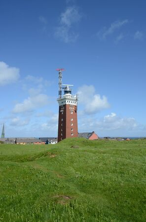 helgoland: Lighthouse on the Island of Helgoland with blue sky Stock Photo