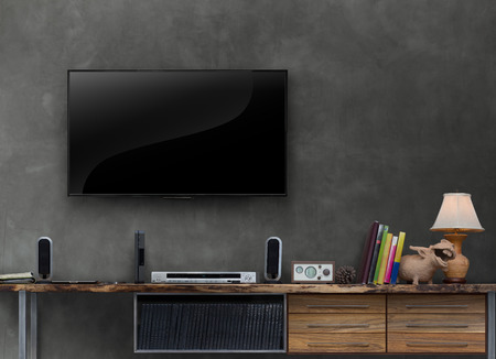 led tv on concrete wall with media furniturein living room Stock Photo