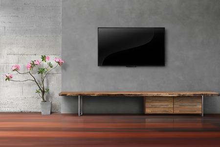 Salón LED TV en la pared de hormigón con soporte de madera vacía