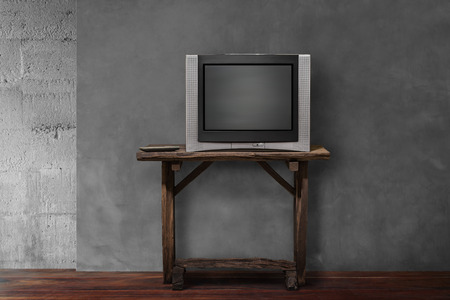 outmoded: obsolete tv on old wooden in empty living room