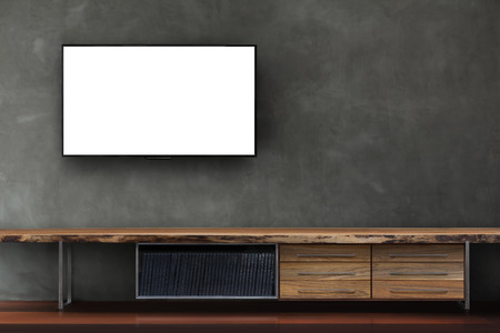 led tv on concrete wall with wooden media furniture in living room modern loft style 版權商用圖片