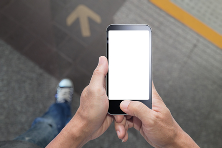 Hands holding walk and using smartphone blank screen