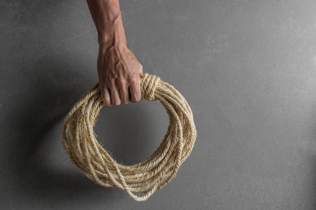 Hand holding ship rope