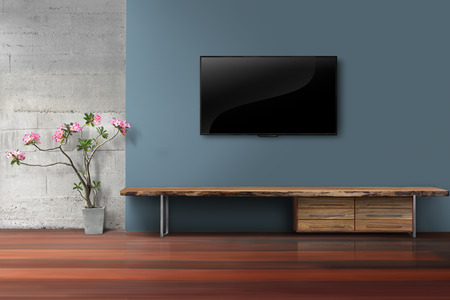 Living room led tv on blue color wall with empty wooden stand