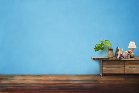 green plants pottery vase on drawer wooden in empty blue vintage living room interior Reklamní fotografie - 69240368