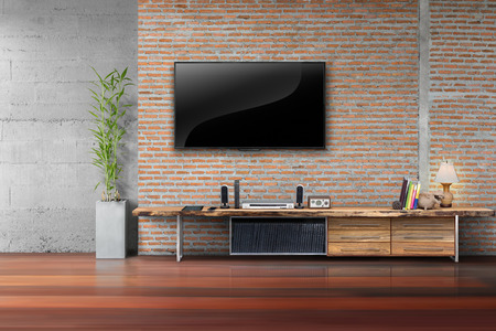 Living room led tv on brick wall with wooden table and plant in pot empty interior 版權商用圖片