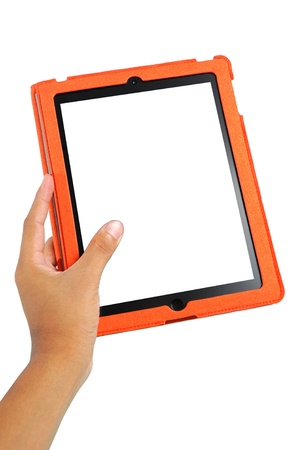 Hand holding the touch screen tablet with white screen and orange case photo