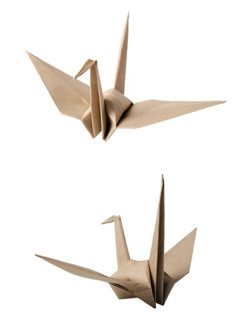 The origami bird made from recycled paper photo