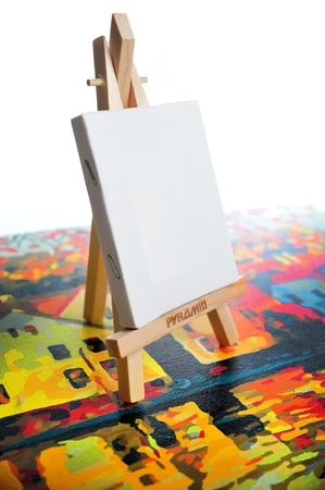 Blank canvas on easel on another picture frame Stock Photo - 14366509