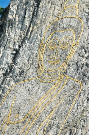 Laser Buddha Image on the cliff at Khao Chee Chan, Pattaya photo