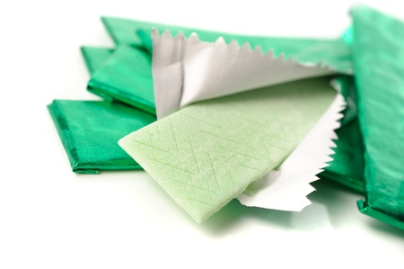 chewing gum and the wrapping foil on white photo