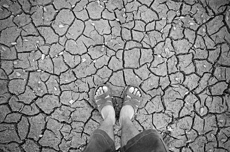 human standing on dry soil  photo