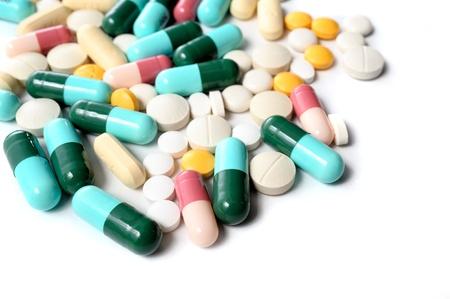 antibiotic pill: many pills on white background