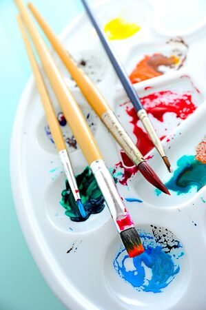 watercolor tray and paint brush photo