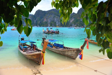 Long Tailed Boats at the beach in southern of Thailand photo