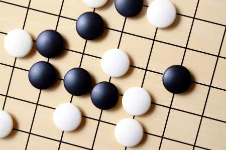 wei: closeup view of stones on a Go board Stock Photo
