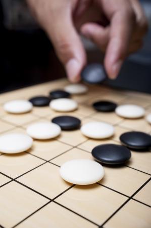 碁盤上では石のクローズ アップ ビュー