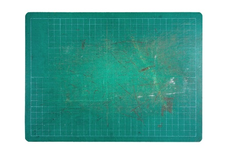 used green cutting mat on white background photo
