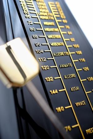 metronome: closeup musical metronome, musical time keeping