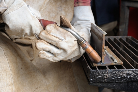 mag: Welder practice to holding MAG welding torch Stock Photo