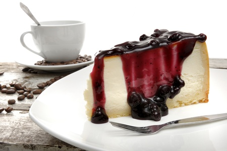 new york cheese cake with blueberry jam on top photo