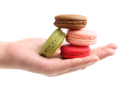 closeup colorful french macarons in hand Stock Photo