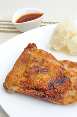 protien: Thailand northeast style of grilled chicken with sticky rice and spicy sauce. Stock Photo