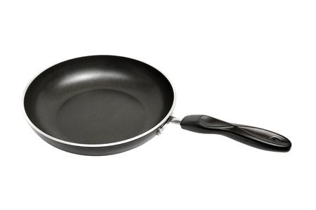 nonstick: black nonstick frying pan on white background  Stock Photo