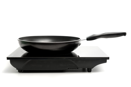nonstick: black nonstick frying pan on electric stove