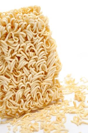 monosodium glutamate: closeup dry instant noodles on white background Stock Photo
