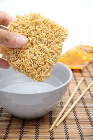 glutamate: dry instant noodles over boiled water in bowl