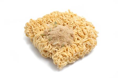 monosodium glutamate: dry instant noodles on white background