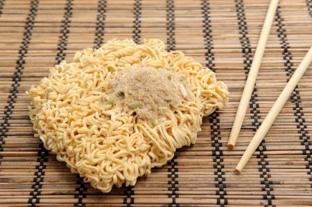 monosodium glutamate: dry instant noodles and chopsticks
