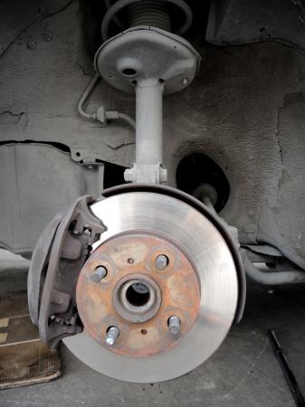 auto hoist: closeup front disc break in maintenance process