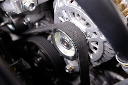 automotive parts: closeup car timing belt in clean engine room