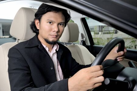 Thai businessman driving a car photo
