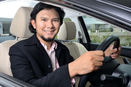 Thai businessman diving a car