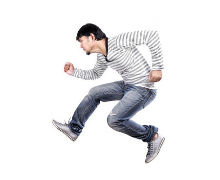 isolated handsome asian man jumping photo