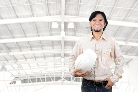 portrait young asian engineer in factory photo
