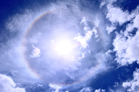 Sun halo with blue sky and white cloud