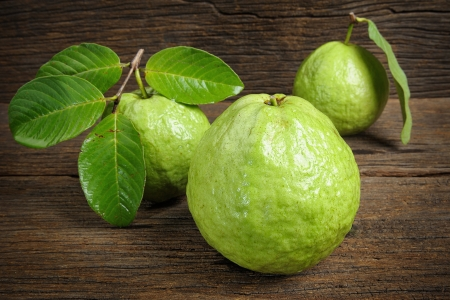 fresh guavas on wooden table photo